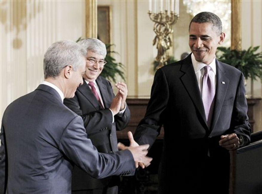 President Barack Obama shakes hands with outgoing White House Chief of Staff Rahm Emanuel, left, as he announces his new interim Chief of Staff Pete Rouse, center, Friday, Oct. 1, 2010, in the East Room of the White House in Washington. Emanuel will return to Chicago to run for mayor. (AP Photo/Pablo Martinez Monsivais)