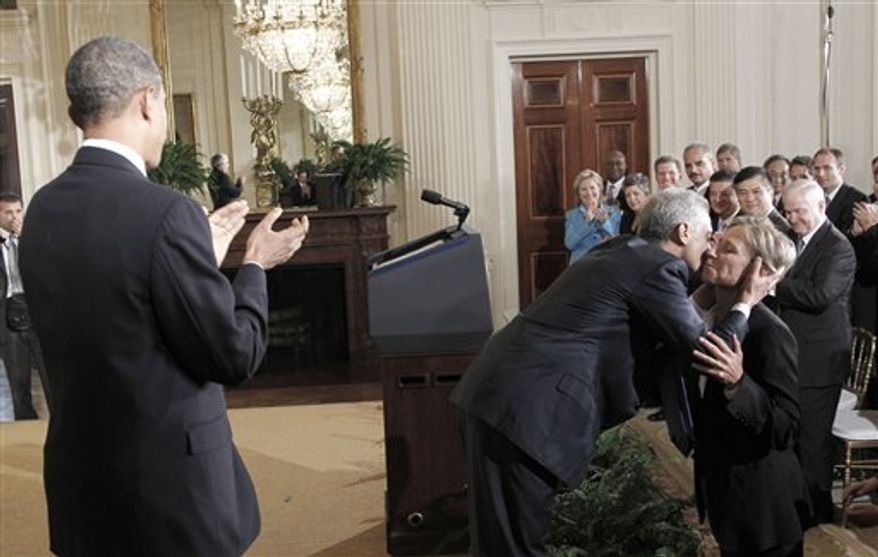 President Barack Obama applauds as outgoing White House Chief of Staff, Rahm Emanuel, center, kisses his wife, Amy Rule, Friday, Oct. 1, 2010, in the East Room of the White House in Washington, where Emanuel's departure was announced.  (AP Photo/Pablo Martinez Monsivais)