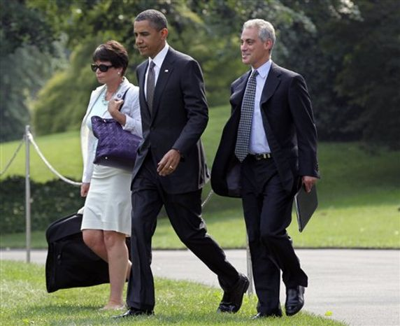 FILE - In this Aug. 4, 2010, file photo, President Barack Obama, joined by adviser Valerie Jarrett and Chief of Staff Rahm Emanuel, right, on the South Lawn of the White House in Washington. Obama is making official what has been clear for days: Rahm Emanuel, the relentless enforcer of his agenda as White House chief of staff, is resigning. (AP Photo/J. Scott Applewhite)