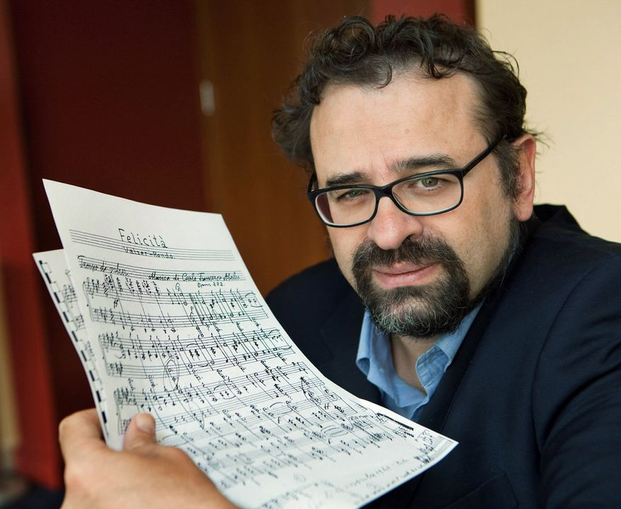 Francesco Lotoro displays sheet music written by Holocaust victims. He has collected 4,000 musical compositions written in Nazi concentration camps. (Associated Press)