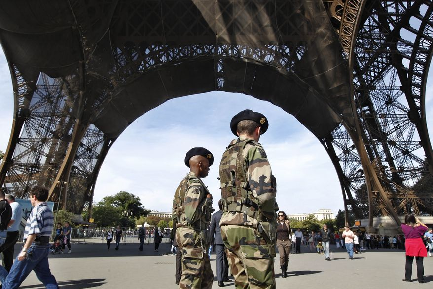 **FILE** French soldiers patrol under the Eiffel Tower in Paris on Sunday, Oct. 3, 2010. The State Department is cautioning Americans traveling in Europe to be vigilant because of heightened concerns about a potential al Qaeda terrorist attack aimed at U.S. citizens and Europeans. The travel alert is general in nature and isn't intended to focus on any specific country, location or tourist site. (AP Photo/Laurent Cipriani)