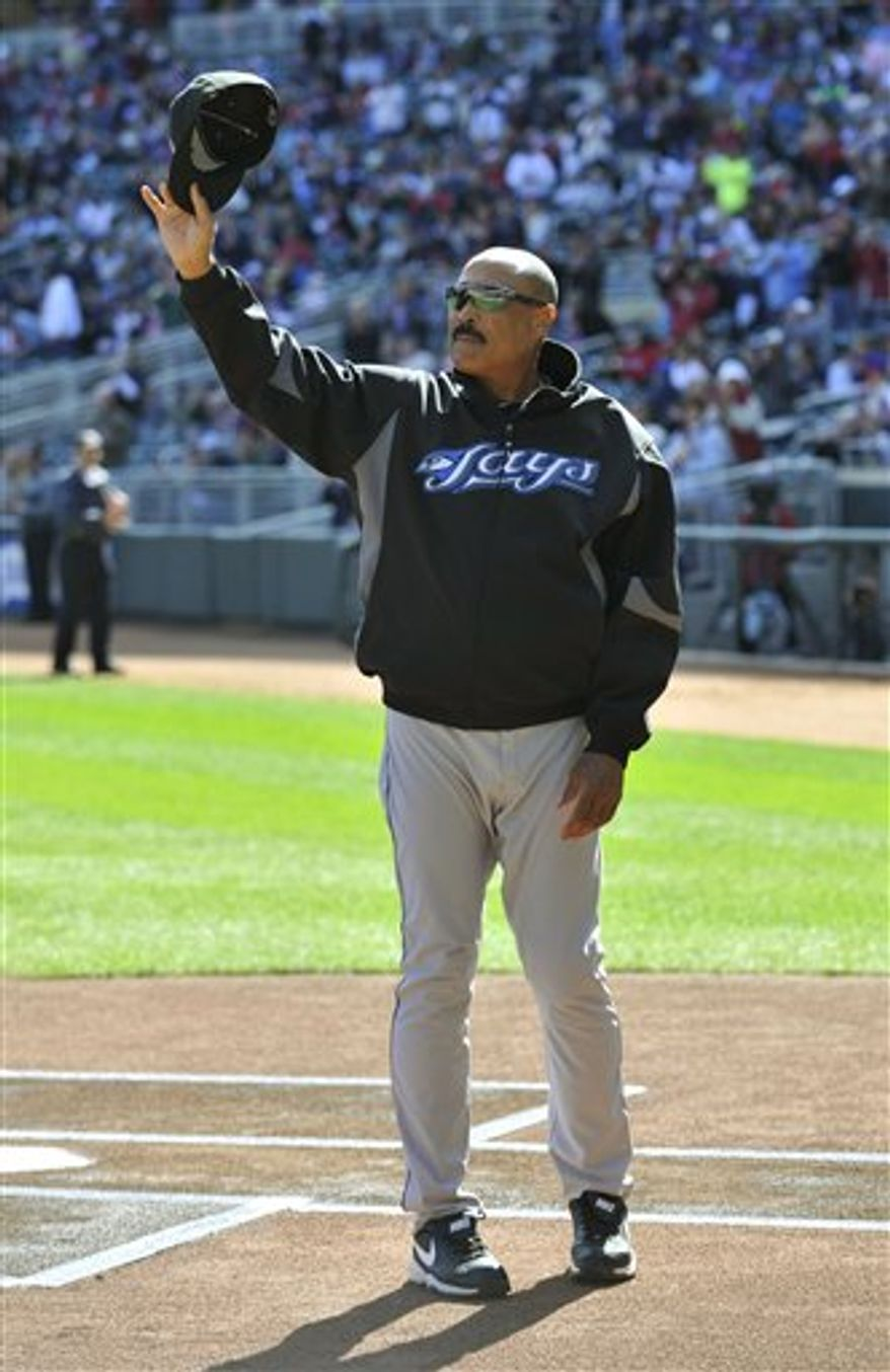 Retiring Toronto Blue Jays manager Cito Gaston looks out from the dugout before a baseball game against the Minnesota Twins, Sunday, Oct. 3, 2010, in Minneapolis. (AP Photo/Jim Mone)