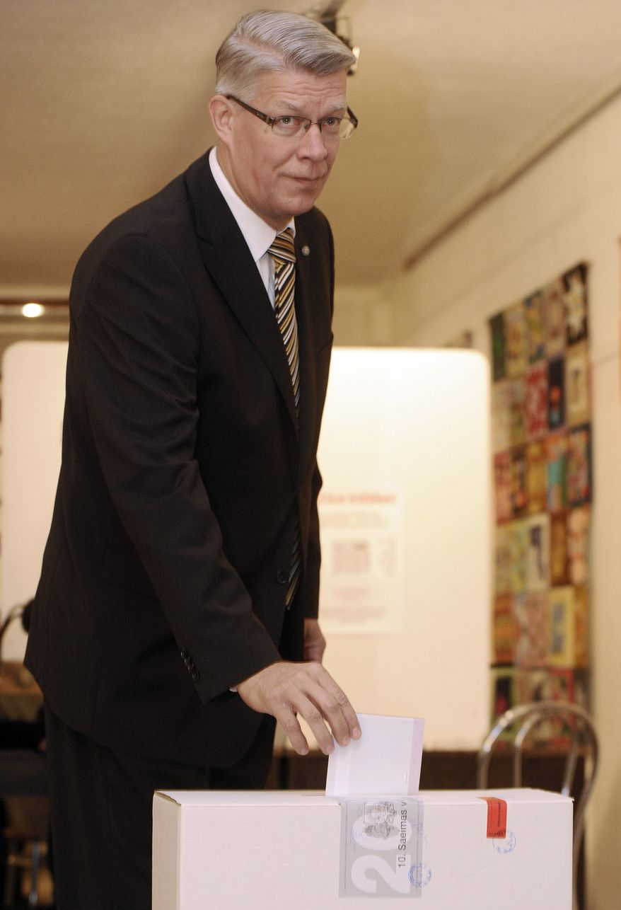 Latvian President Valdis Zatlers casts his ballot at a polling station in Riga, Latvia, on Saturday, Oct. 2, 2010. (AP Photo/Roman Koksarov)