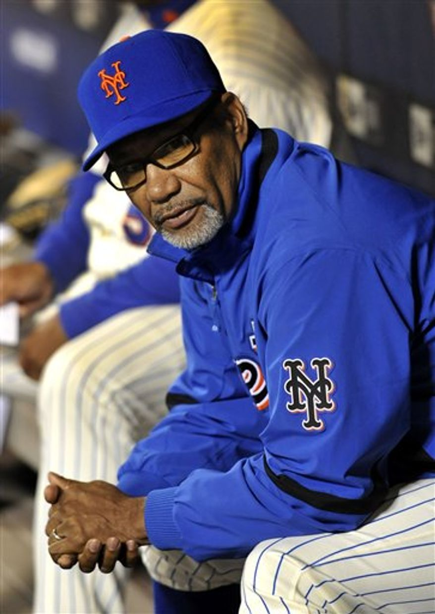 New York Mets manager Jerry Manuel looks from the dugout before a baseball game against Washington Nationals, Friday, Oct. 1, 2010, in New York.  Manuel and general manager Omar Minaya both said Friday they have not been notified they are losing their jobs following another season filled with injuries rather than accomplishments. (AP Photo/Kathy Kmonicek)