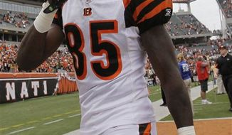 Bengals wide receiver Chad Ochocinco walks off the field after Cincinnati defeated Baltimore in this Sept. 19, 2010, file photo. Charity-minded callers are getting intercepted by a phone-sex line because of a typo on Chad Ochocinco's Cereal boxes. Kroger Co. said Thursday it was pulling all Ochocinco cereal boxes from its grocery shelves because of the error. (AP Photo/Ed Reinke, file)