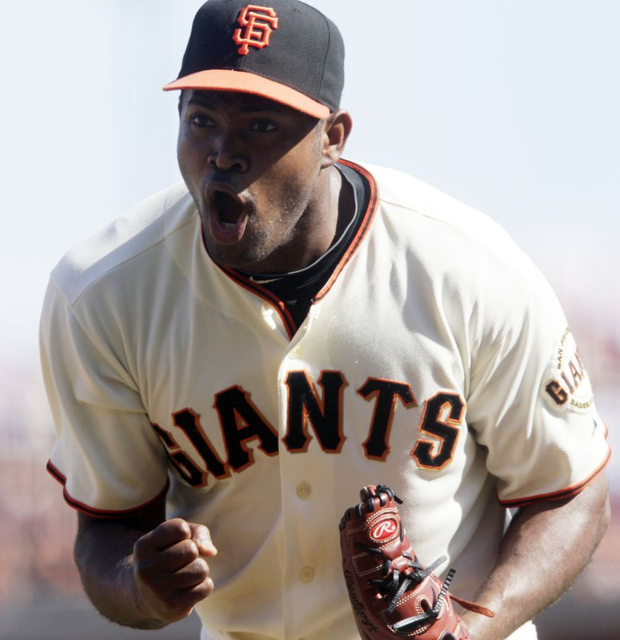 ASSOCIATED PRESS San Francisco Giants' Santiago Casilla celebrates after getting San Diego Padres' Scott Hairston to ground out in the sixth inning of a baseball game in San Francisco, Sunday, Oct. 3, 2010.