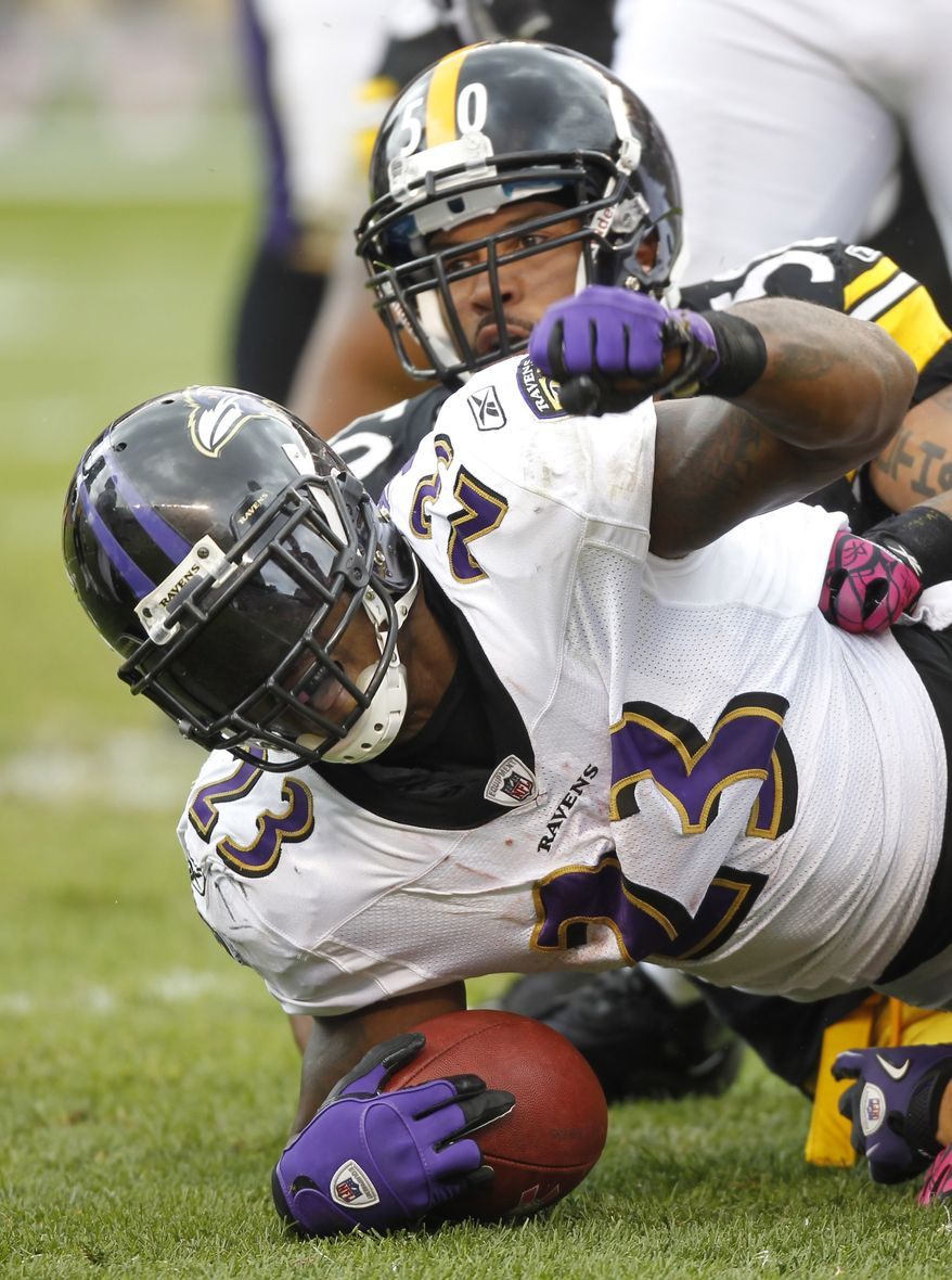 ASSOCIATED PRESS Baltimore Ravens  running back Willis McGahee (23) celebrates making a first down near the goal line in front of Pittsburgh Steelers linebacker Larry Foote (50) in the second quarter of the NFL football game in Pittsburgh, Sunday, Oct. 3, 2010.