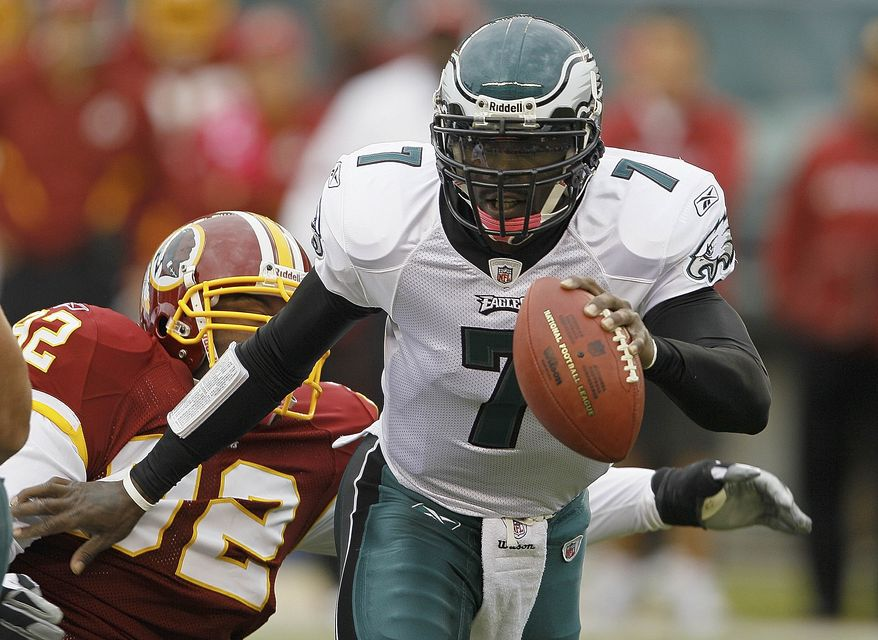 ASSOCIATED PRESS Philadelphia Eagles quarterback Michael Vick scrambles away from Washington Redskins defensive tackle Albert Haynesworth during the first half of an NFL football game in Philadelphia, Sunday, Oct. 3, 2010.