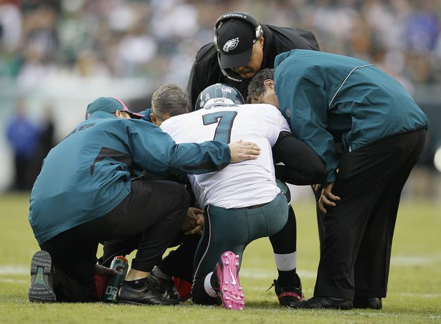 ASSOCIATED PRESS Philadelphia Eagles coach Andy Ried looks on as trainers attend to Philadelphia Eagles quarterback Michael Vick after Vick was injured during the first half of an NFL football game against the Washington Redskins in Philadelphia, Sunday, Oct. 3, 2010.