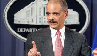 """We will not tolerate anti-competitive practices,"" Attorney General Eric H. Holder Jr. said Monday. (Associated Press)"