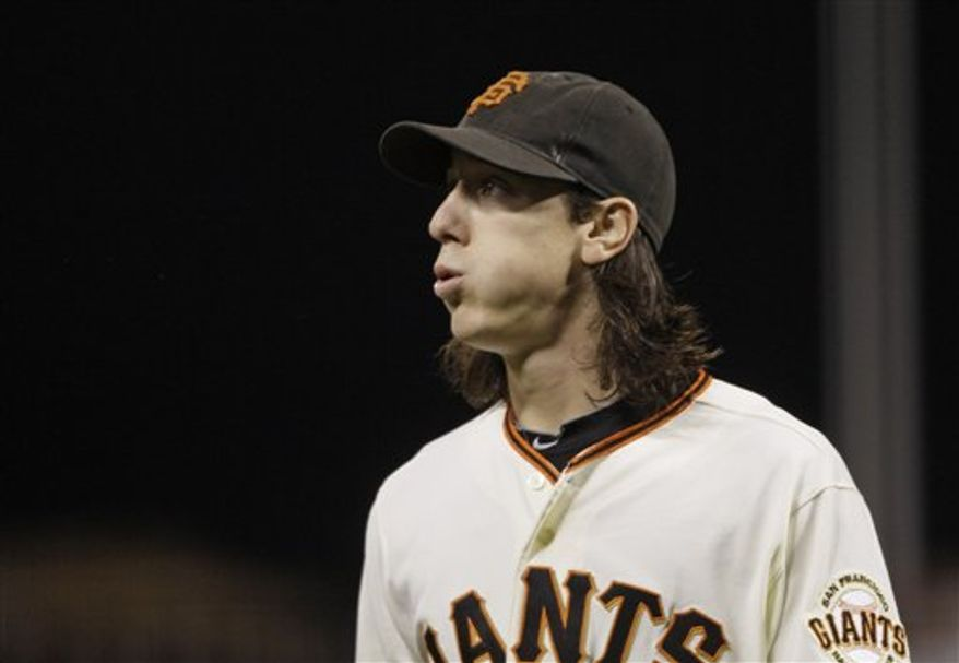 San Francisco Giants starting pitcher Tim Lincecum walks back to the dugout after pitching against the Arizona Diamondbacks during the fourth inning of their baseball game in San Francisco, Wednesday, Sept. 29, 2010. San Francisco won the game 3-1 and Lincecum struck out 11 in seven innings. (AP Photo/Eric Risberg)