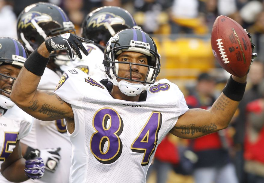 ASSOCIATED PRESS Baltimore Ravens wide receiver T.J. Houshmandzadeh (84) celebrates making a touchdown catch with less than a minute to go in the NFL football game, giving the Ravens the lead over the Pittsburgh Steelers in Pittsburgh, Sunday, Oct. 3, 2010. The Ravens won 17-14.