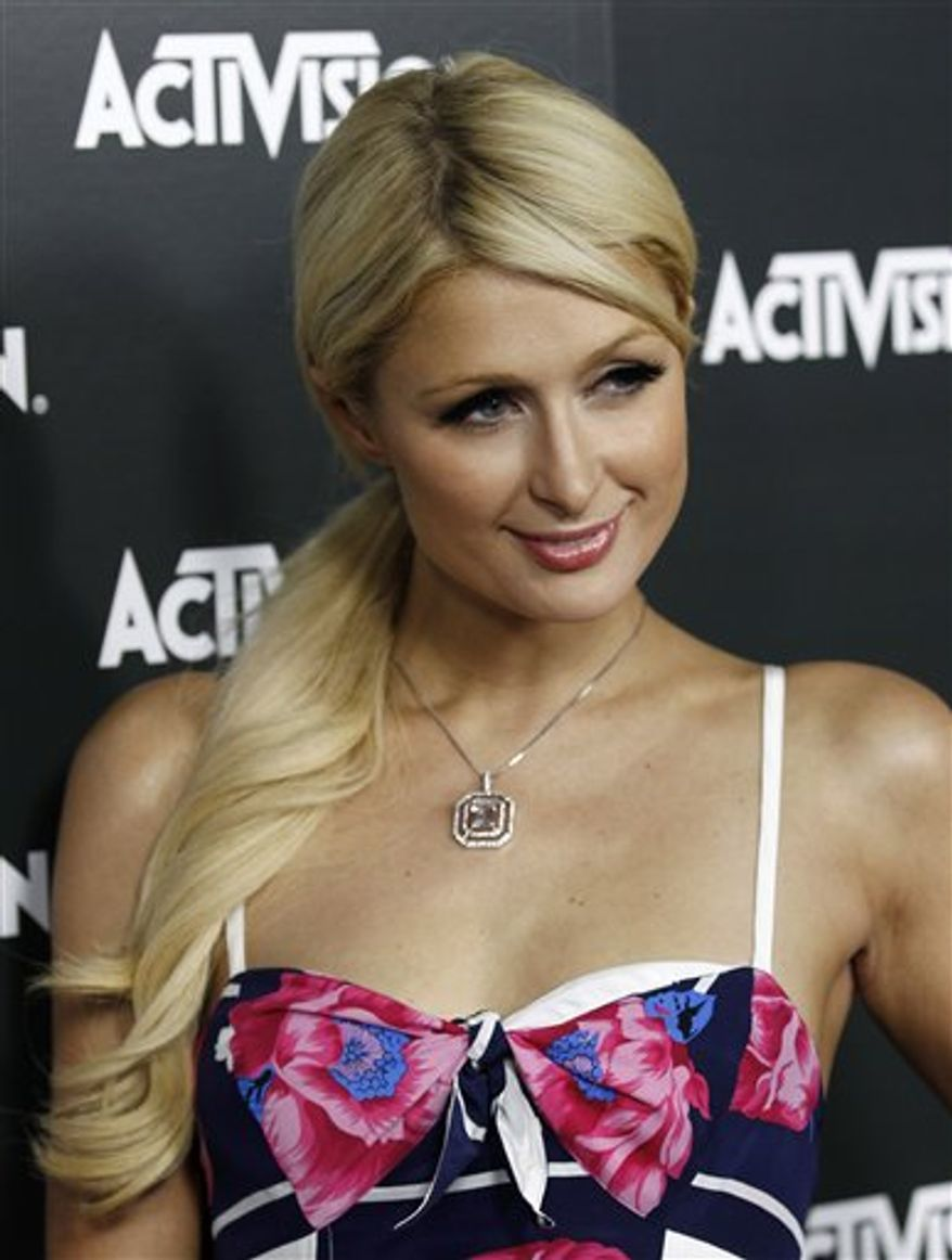 FILE - In this Nov. 10, 2010 file photo, Paris Hilton arrives to the 2010 Victoria's Secret Fashion show in New York. (AP Photo/Peter Kramer, file)