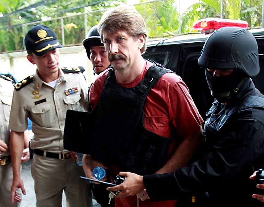 Under heavy security and wearing a bulletproof vest Viktor Bout, center, an alleged Russian arms smuggler, arrives Monday, Oct. 4, 2010, at a Bangkok criminal court for a crucial hearing that could finally determine if he will be extradited to the United States. (AP Photo/Apichart Weerawong)