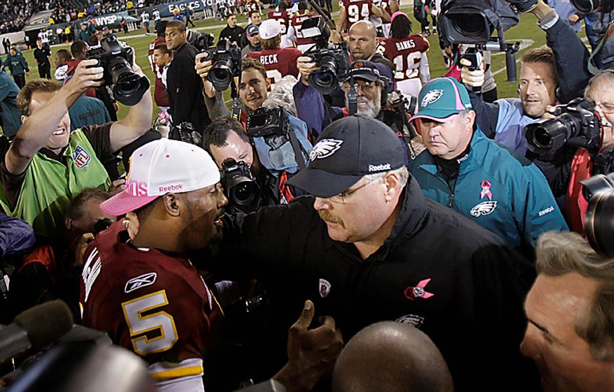 Washington Redskins quarterback Donovan McNabb, left, talks with Philadelphia Eagles coach Andy Reid after the Redskins defeated the Eagles 17-12 in an NFL football game in Philadelphia, Sunday, Oct. 3, 2010. (AP Photo/Rob Carr)