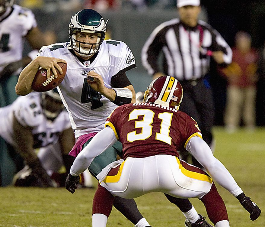 Philadelphia Eagles quarter back Kevin Kolb dodges Washington Redskins cornerback Phillip Buchanon during third quarter Philadelphia Eagles-Washington Redskins game action in Philadelphia at Lincoln Financial Field October 3, 2010.  Kolb replaced Michael Vick who was injured in the first quarter. Washington defeated Philadelphia 17-12. UPI/John Anderson