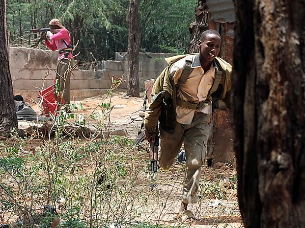 Islamist  fighters take positions during clashes with Somali government soldier and African union peacekeepers in southern Mogadishu's Hodon neighborhood, Somalia,  Monday, Oct. 4, 2010. Ali Muse, the head of Mogadishu's ambulance service, says a spike in violence the last three days in Mogadishu has killed at least 20 civilians. More than 70 people have been wounded.(AP Photo/Farah Abdi Warsameh)