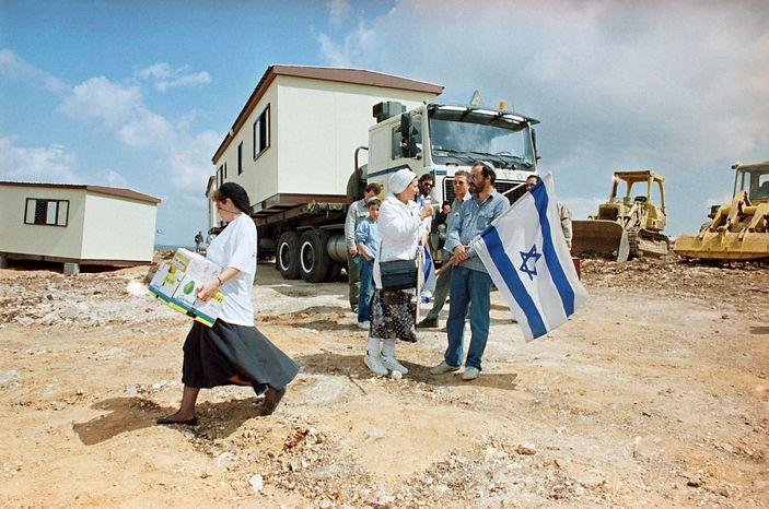 THEN: On April 16, 1991, Jewish settlers establish themselves in Revava, near the West Bank city of Nablus. Nearly two decades ago, when Revava was established, the U.S. was trying hard to push Israelis and Palestinians toward a peace agreement. (Associated Press)