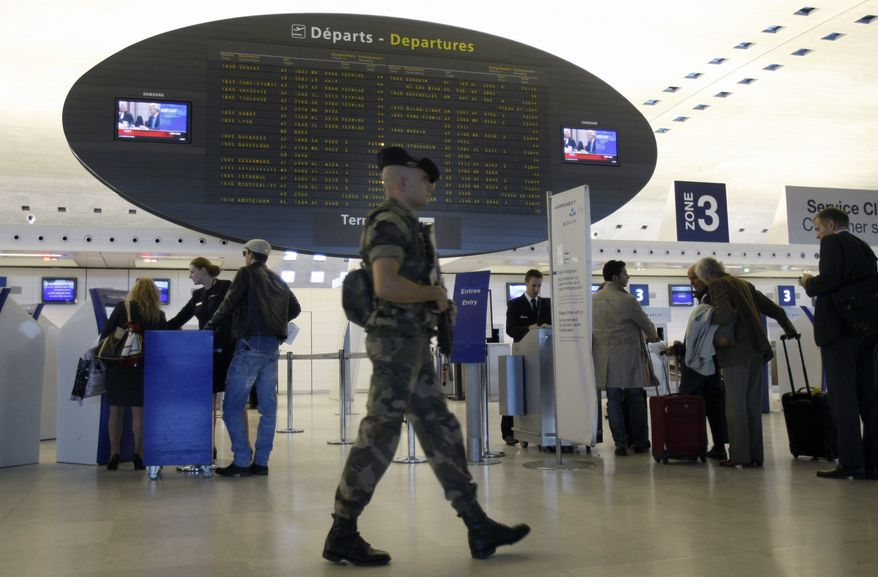 ** FILE ** A French soldier patrols a terminal at Paris' Charles de Gaulle Airport on Monday, Oct. 4, 2010. (AP Photo/Remy de la Mauviniere)