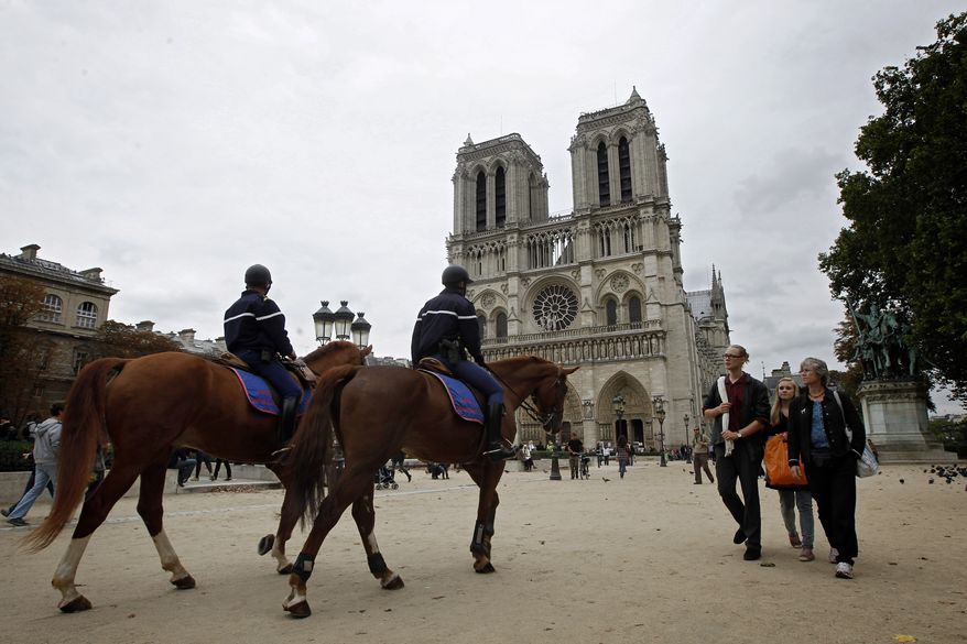 Mounted police patrol outside Notre-Dame Cathedral in Paris on Monday, Oct. 4, 2010. Japan issued a travel alert for Europe on Monday, joining the United States, Sweden and Britain in warning of a possible terrorist attack by al Qaeda or other militant groups, but tourists appeared to be taking the mounting warnings in stride. (AP Photo/Laurent Cipriani)