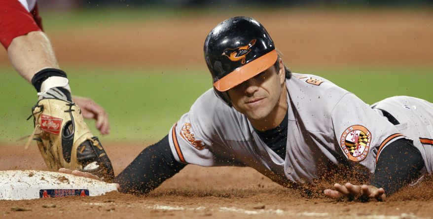 ASSOCIATED PRESS Baltimore Orioles' Brian Roberts  dives back safely on a pickoff attempt ahead of a tag by Boston Red Sox first baseman Lars Anderson in the third inning of a baseball game at Fenway Park in Boston, Tuesday, Sept. 21, 2010.