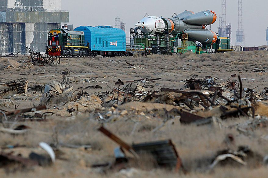 The Russian Soyuz TMA-01M space ship that will carry new crew to the international space station is transported from hangar to the launch pad at the Russian leased Baikonur cosmodrome, Kazakhstan, Tuesday, Oct. 5, 2010. Start of the new Soyuz mission is scheduled on Friday, Oct. 8. (AP Photo/Dmitry Lovetsky)