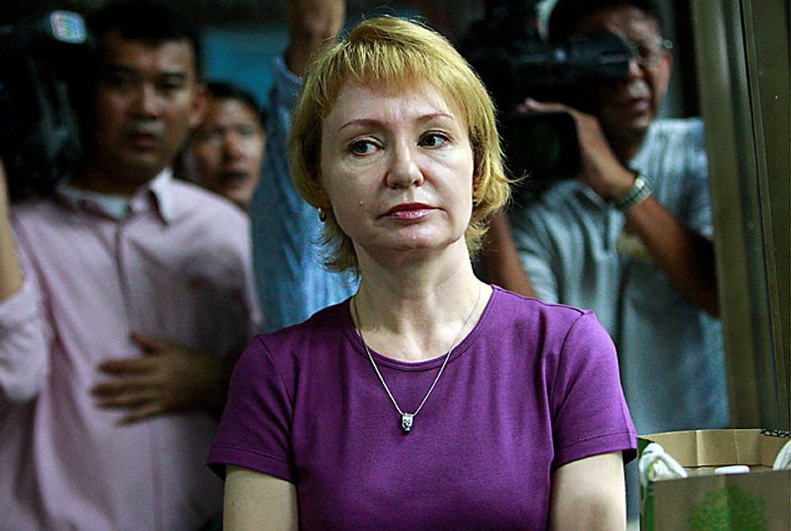 Alla Bout, wife of suspected Russian arms smuggler Viktor Bout, waits with a bag of food to hand to her husband at the criminal court in Bangkok, Thailand Tuesday, Oct. 5, 2010. A Thai court dismissed secondary charges of money laundering and fraud against the 43-year-old, clearing the way for extradition to the US where he faces charges of conspiring to kill American citizens.  (AP Photo/Apichart Weerawong)