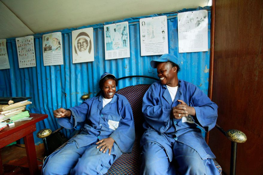 Mechanic cousins Fatou Kamara (left) and Fatou Sylla own an auto-repair shop in Dakar, Senegal, and employ eight men in a nation where few women work outside the home and those who do usually choose jobs such as sewing or hairstyling. (Associated Press)