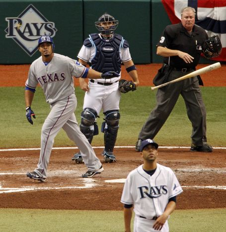 ASSOCIATED PRESS Texas Rangers' Nelson Cruz, left, watches his third inning home run along with Tampa Bay Rays  catcher Kelly Shoppach, pitcher David Price and home plate umpire Tim Welke during Game 1 of the American League Division baseball series, Wednesday, Oct. 6, 2010, in St. Petersburg, Fla.
