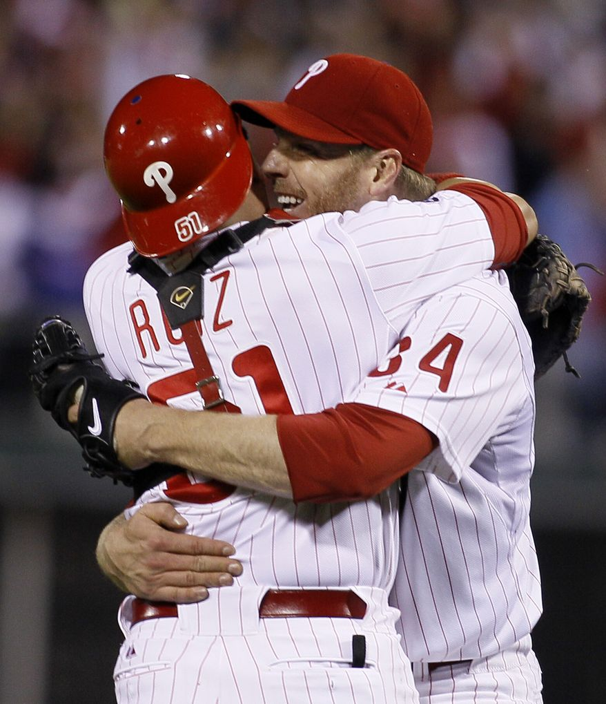 ASSOCIATED PRESS Philadelphia Phillies starting pitcher Roy Halladay  celebrates with catcher Carlos Ruiz (51) after throwing a no-hitter to defeat the Cincinnati Reds 4-0 during Game 1 of baseball's National League Division Series, Wednesday, Oct. 6, 2010, in Philadelphia.