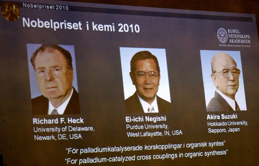 Portraits on overhead screen from left, show American Richard Heck and Japanese researchers Ei-ichi Negishi and Akira Suzuki who won the 2010 Nobel Prize in chemistry on Wednesday Oct. 6, 2010 for developing a chemical method that has allowed scientists to make medicines and better electronics as members of the Royal Academy of Sciences announce the Nobel Prize in Chemistry in Stockholm, Sweden.  (AP Photo/Scanpix Sweden/Janerik Henriksson)