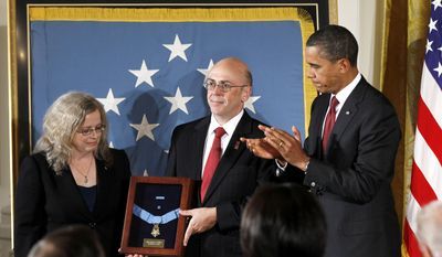 President Obama stands with Phil and Maureen Miller, parents of Army Staff Sgt. Robert J. Miller, on Wednesday, Oct. 6, 2010, in the East Room of the White House in Washington as the soldier posthumously is awarded the Medal of Honor for his actions in Afghanistan. (AP Photo/Charles Dharapak)