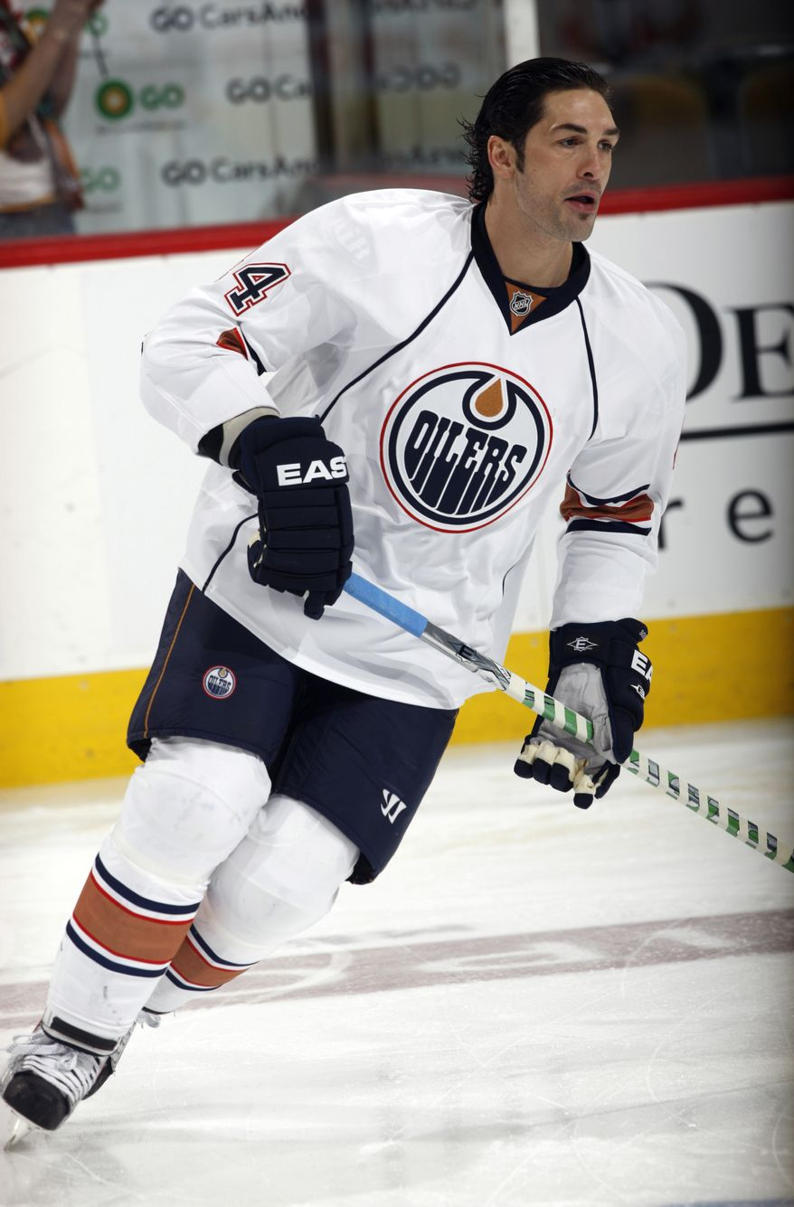 ASSOCIATED PRESS FILE In this Jan. 18, 2010, photo, Edmonton Oilers defenseman Sheldon Souray warms up before the Oilers NHL hockey game against the Colorado Avalanche in Denver. The Oilers loaned disgruntled defenseman Souray to the Hershey Bears of the American Hockey League on Wednesday, Oct. 6, 2010. After failing to trade Souray  or get another team to claim him on waivers, general manager Steve Tambellini sent the 32-year-old defenseman to Hershey, the Washington Capitals' top farm club, instead of the Oilers' affiliate in Oklahoma City.