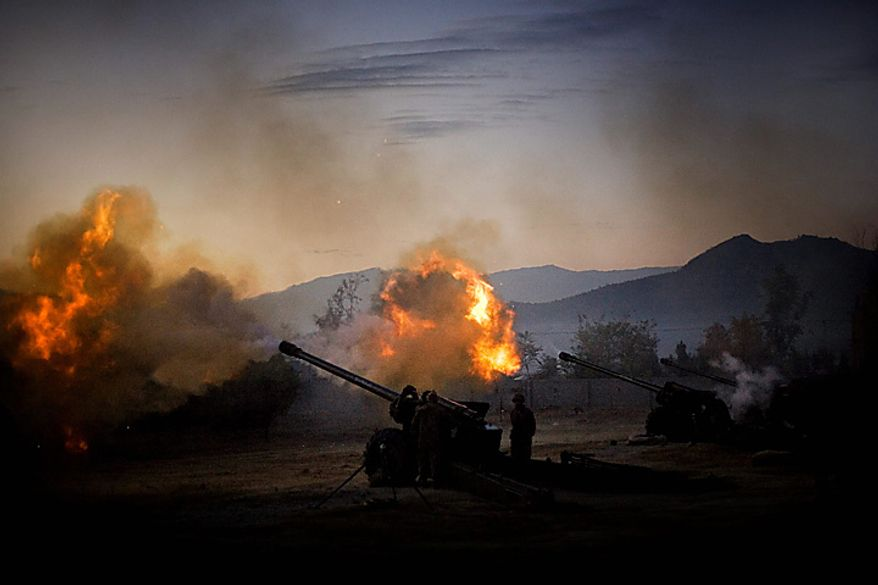 In this Thursday, Nov. 27, 2008 file picture, Pakistani army 130mm artillery guns fire towards militant positions in the Bajur tribal region on the border with Afghanistan, Pakistan. Pakistan is battling surging attacks by al-Qaida and Taliban militants. Most of them are based in the rugged and lawless tribal region across from Afghanistan, where U.S. and NATO forces are fighting an increasingly tenacious Islamist insurgency. Al-Qaida leaders Osama bin Laden and Ayman al-Zawahri are believed to be hiding somewhere along the border. (AP Photo/Emilio Morenatti, File)
