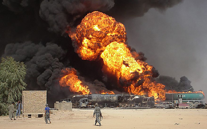 In this Tuesday, Sept 11, 2007 file picture, plumes of fire and smoke fill the sky after a suicide car bomb explosion which hit fuel tanker trucks on the main highway of Helmand province, south of Kabul, Afghanistan. (AP Photo/Abdul Khaleq, File)