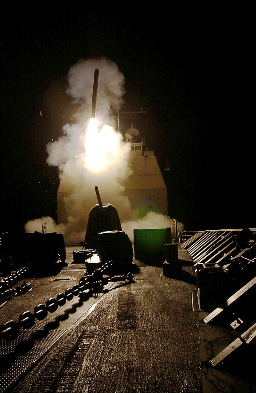 In this Sunday, Oct. 7, 2001 U.S. Navy handout file picture, a Tomahawk cruise missile is launched from the USS Philippine Sea against military targets and Osama bin Laden's training camps inside Afghanistan. (AP Photo/U.S. Navy, Terry Cosgrove, File)