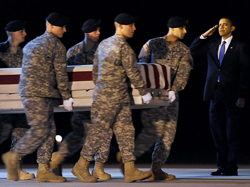 In this Thursday, Oct. 29, 2009 file picture, President Barack Obama, right, salutes as a carry team walks with the transfer case containing the remains of Army Sgt. Dale R. Griffin of Terre Haute, Ind., who died in Afghanistan according to the Department of Defense, during a dignified transfer at Dover Air Force Base in Dover, Del. (AP Photo/Susan Walsh, File)