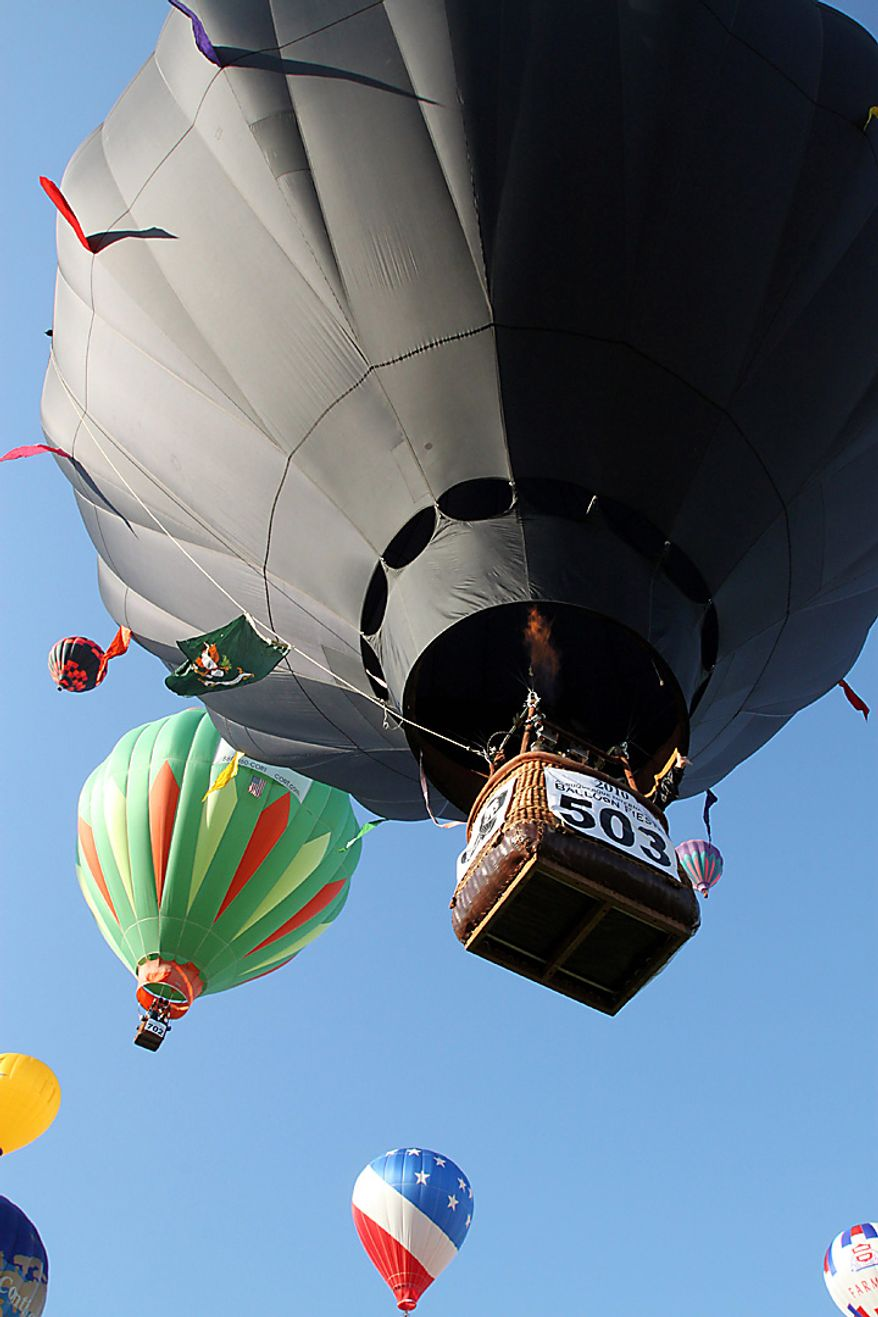 Pilot and deputy director of the America's Challenge gas balloon race Kevin Knapp lifts off in the Wounded Warrior Project balloon #503 at the Albuquerque International Balloon Fiesta in Albuquerque, N.M., on Saturday, Oct. 2, 2010.  (AP Photo/Susan Montoya Bryan)