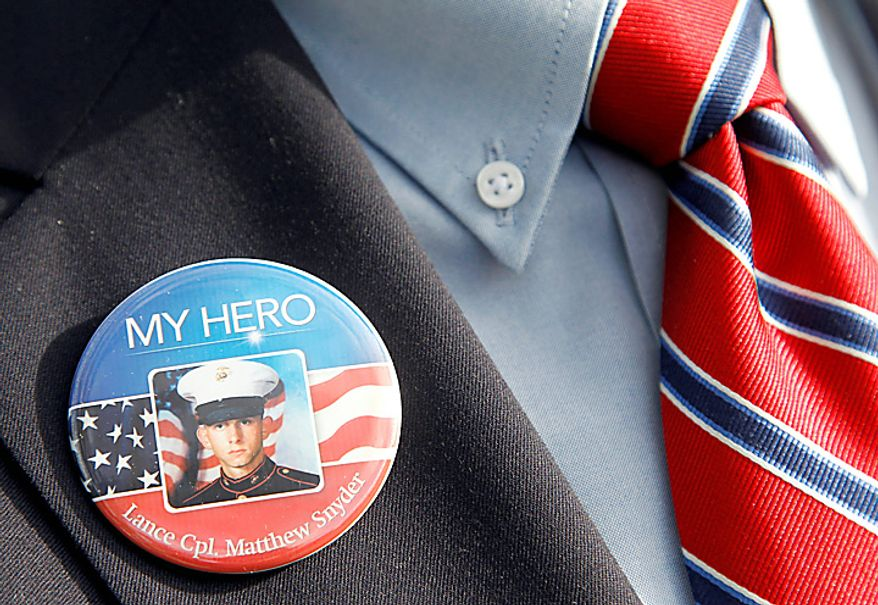 A visitor to the Supreme Court wears a badge in honor of Marine Lance Cpl. Matthew Snyder, Wednesday, Oct. 6, 2010, in Washington. The court is hearing arguments Wednesday in the dispute between Albert Snyder of York, Pa., and members of the Westboro Baptist Church of Topeka, Kan. The case pits Snyder's right to grieve privately against the church members' right to say what they want, no matter how offensive.(AP Photo/Haraz N. Ghanbari)