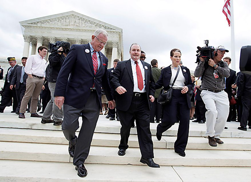 Albert Snyder of York, Pa., second from left, leaves theSupreme Court in Washington, Wednesday, Oct. 6, 2010, with retired Air Force Maj. Gen. Larry Twitchell, left, after the court heard  arguments in the dispute between Snyder and the Westboro Baptist Church of Topeka, Kansas.  (AP Photo/Carolyn Kaster)