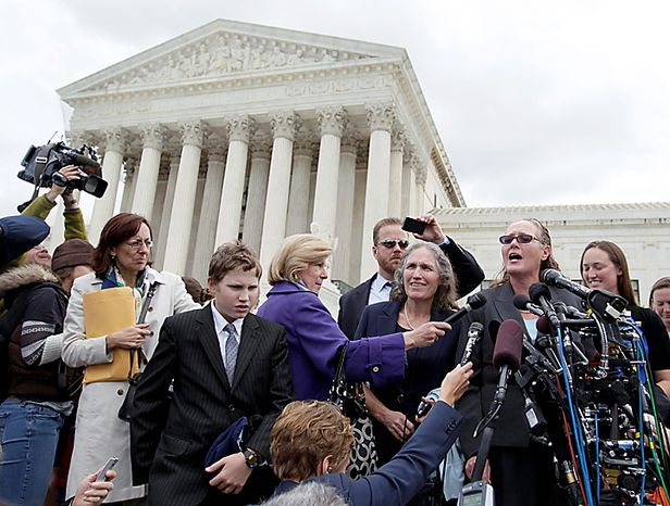 Margie Phelps, right, and Shirley Phelps-Roper, second from right, of the Westboro Baptist Church, of Tokepa Kan.,  speak to the press in front of the Supreme Court in Washington, Tuesday, Oct. 5, 2010, after the court heard arguments in the dispute between Albert Snyder, of York, Pa., and the Westboro Baptist Church.  (AP Photo/Carolyn Kaster)