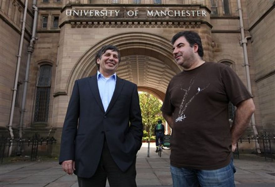 """Professor Andre Geim, left, and Dr Konstantin Novoselov who have have been awarded the Nobel Prize for Physics are seen outside Manchester University, Manchester, England, Tuesday, Oct, 5, 2010. The  scientists shared the Nobel Prize in physics on Tuesday for """"groundbreaking experiments"""" with the thinnest, strongest material known to mankind  a carbon vital for the creation of faster computers and transparent touch screens. (AP Photo/Jon Super)."""