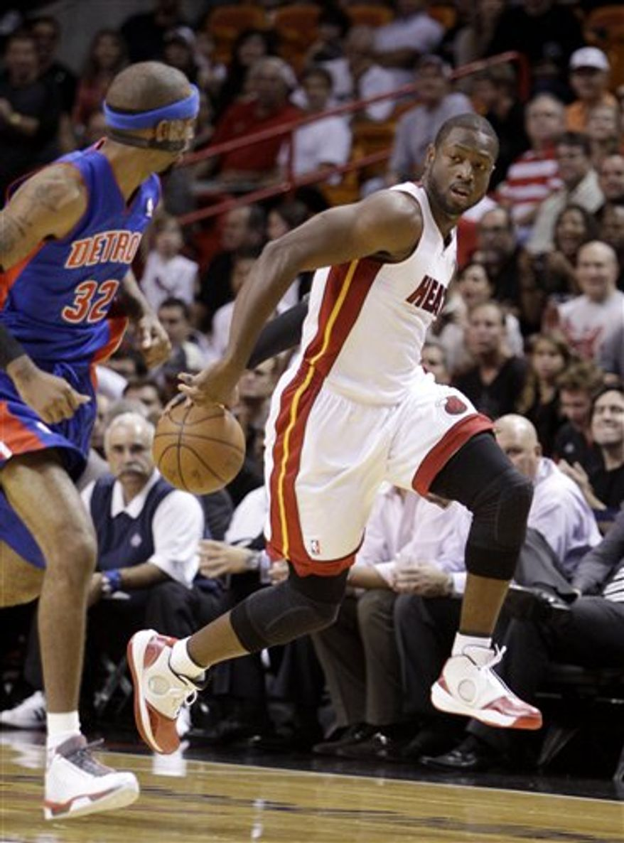 Miami Heat guard Dwyane Wade drives past Detroit Pistons guard Richard Hamilton during the first quarter of a preseason NBA basketball game Tuesday, Oct. 5, 2010, in Miami. Wade lasted only 3 minutes, 17 seconds before leaving with a strained right hamstring. (AP Photo/Lynne Sladky)
