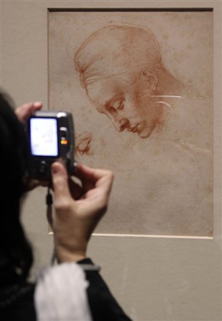 "Visitors look on drawings of Michelangelo Buonarroti in the Albertina museum, in Vienna, Austria, on Wednesday, Oct. 6, 2010. The exhibition called ""Michelangelo  drawing of a genius"" is the first major show in more than 20 years and includes 120 of his most precious drawings. (AP Photo/Ronald Zak)"