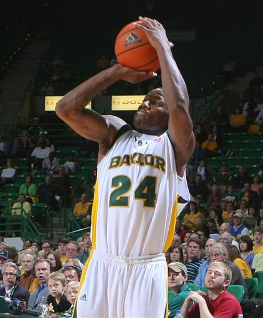 FILE - In a Nov. 24, 2008, file photo, Baylor's LaceDarius Dunn shoots against Jacksonville in second half of an NCAA college basketball game in Waco, Texas. Baylor indefinitely suspended Dunn on Tuesday, Oct. 5, 2010, after he surrendered to police to face an aggravated assault charge accusing him of breaking his girlfriend's jaw during an argument last week. (AP Photo/ Waco Tribune Herald, Jerry Larson, File)