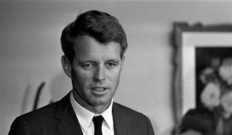 A 1964 file photo shows then U.S. Attorney Gen. Robert F. Kennedy in his office in Washington, D.C. Kennedy owned one of 48 printed copies of the Emancipation Proclamation that were signed by Lincoln, and now the copy Kennedy purchased in 1964 is being sold by his widow, Ethel, in a Dec. 10 sale at Sotheby's. (AP Photo) ** FILE **