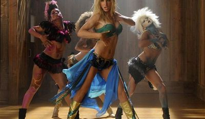 "In this publicity image released by Fox, Heather Morris portrays Britney Spears, center, in the ""Britney/Brittany"" episode of ""Glee."" (AP Photo/Fox, Michael Yarish)"