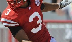 This photo from Sept. 11, 2010,  shows Nebraska safety Rickey Thenarse (3) celebrating after scoring a touchdown on an interception against Idaho in an NCAA college football game in Lincoln. The senior safety is making the most of an extra year of eligibility he received after tearing a major ligament in his right knee early last season. He's now one of the leaders in the Cornhuskers' strong secondary. (AP Photo/Dave Weaver)