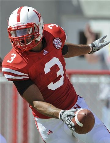 This photo from Sept. 11, 2010,  shows Nebraska safety Rickey Thenarse (3) celebrating after scoring a touchdown on an interception against Idaho in an NCAA college football game in Lincoln. The senior safety is making the most of an extra year of eligibility he received after tearing a major ligament in his rig