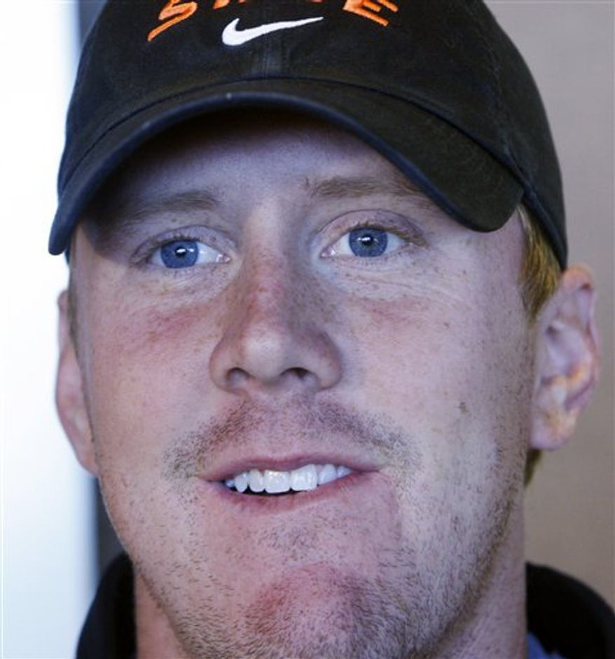 In this photo taken Monday, Oct. 4, 2010, Oklahoma State quarterback Brandon Weeden looks on during an interview in Stillwater, Okla. Weeden is one of 14 players expected to make their first road start for the Cowboys on Friday night when they travel to face Louisiana-Lafayette in an NCAA college football game. (AP Photo/Sue Ogrocki)